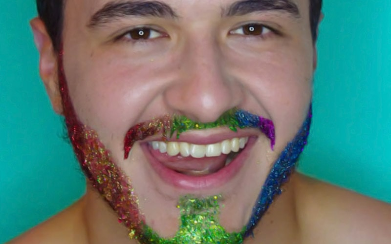 A man with glittery make up on his facial hair