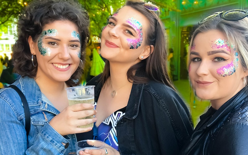 Three girls with glitter on their faces