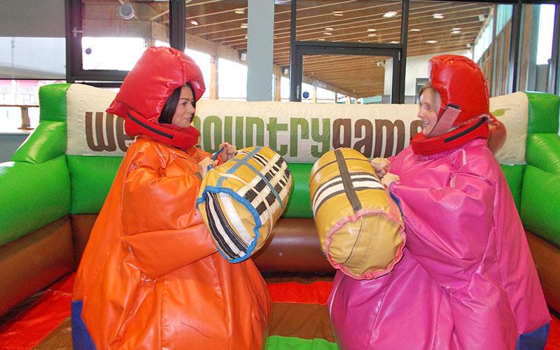 Two girls playing the Vicky Pollard Handbag game
