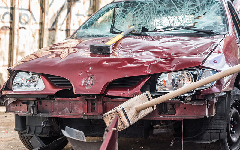 A car that has been smashed by weapons