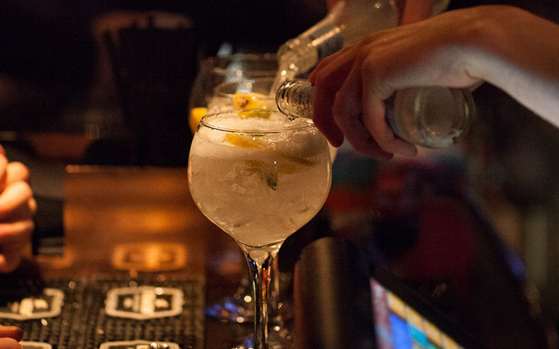 Two drinks being poured on the bar in Perdu