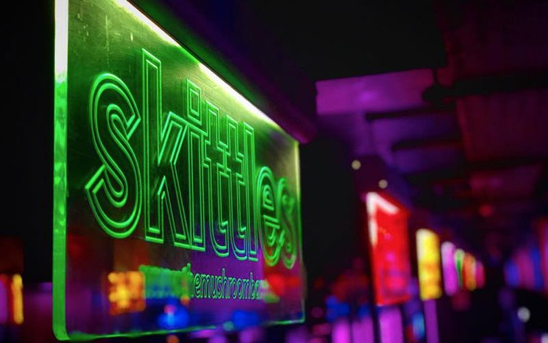 A neon sign inside Mushroom bar