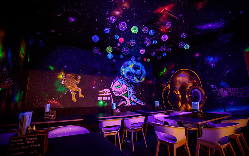 A seating area in the space golf course