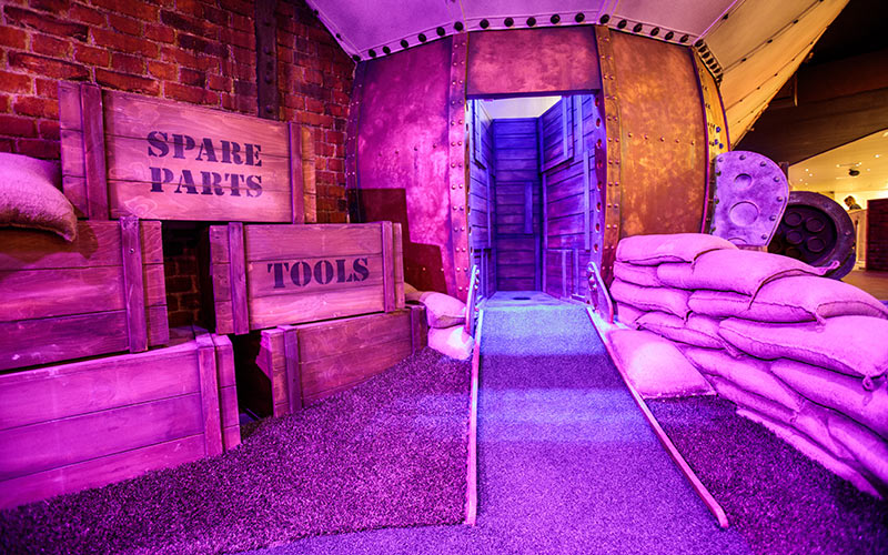 Some boxes and sandbags lined up in the space golf arena