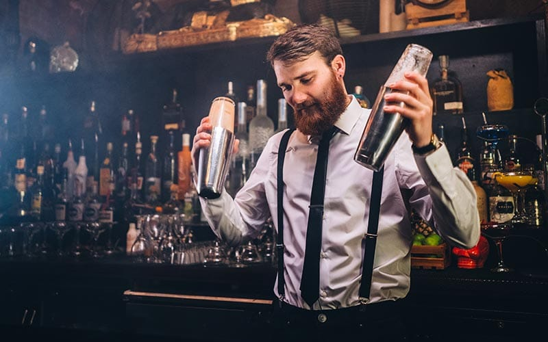 Image of bartender shaking cocktail shakers