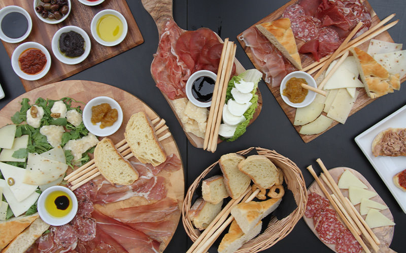 Some antipasto foods laid out on a table