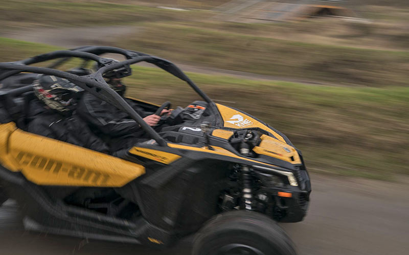 An off road buggy being driven on an outdoor track