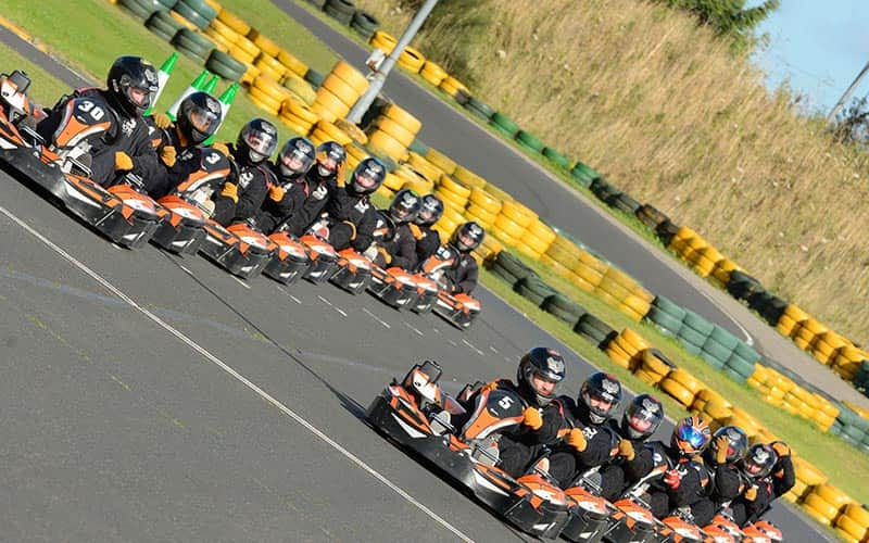 People lined up in go karts at Karting North East