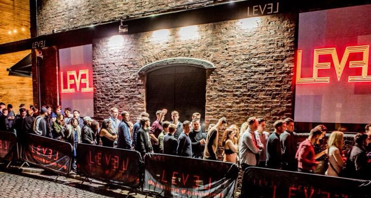 A group of people outside Level nightclub