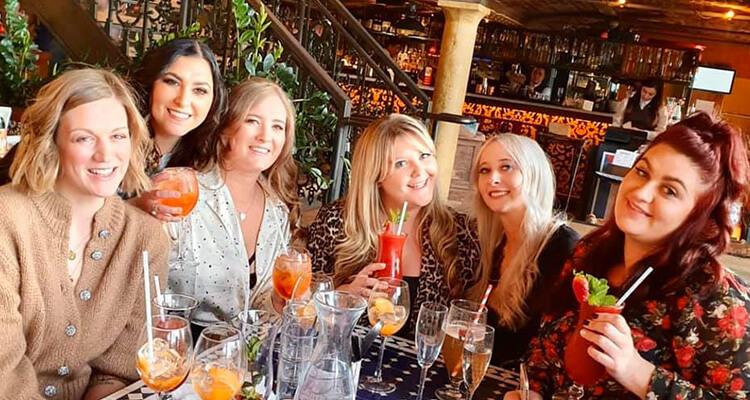 A group of women drinking at Revolución de Cuba Liverpool