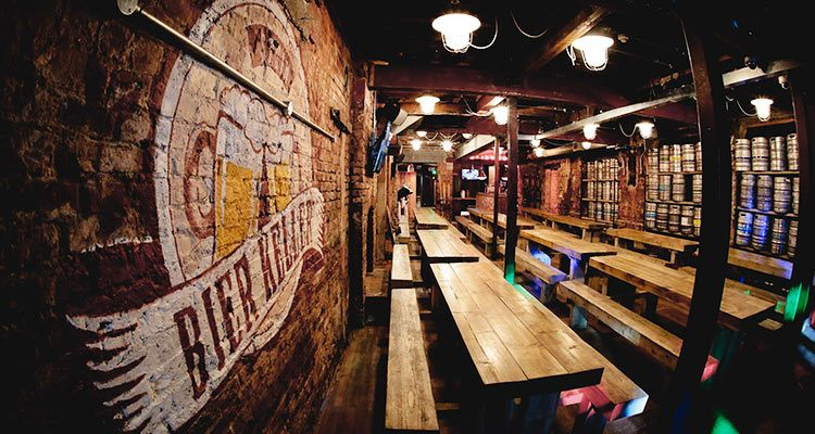 The interior of Bier Keller, Newcastle, with wooden benches and seats