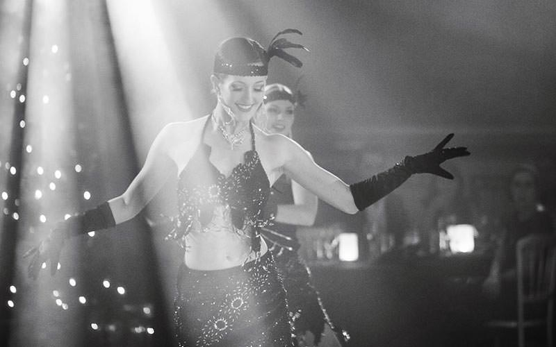 A woman wearing 1920s outfit, dancing