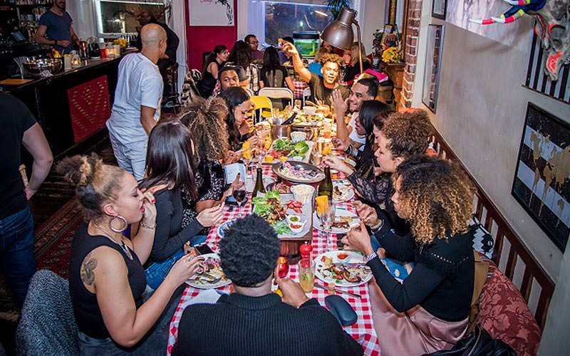 People sat eating dinner at a long table