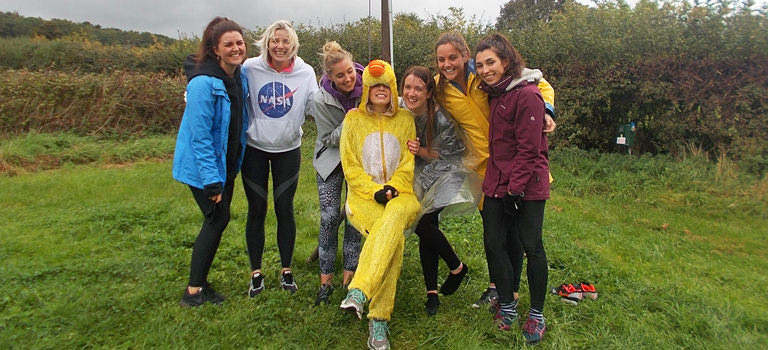 A group of women and one woman dressed as a duck