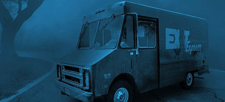 A van parked in an eerie scene