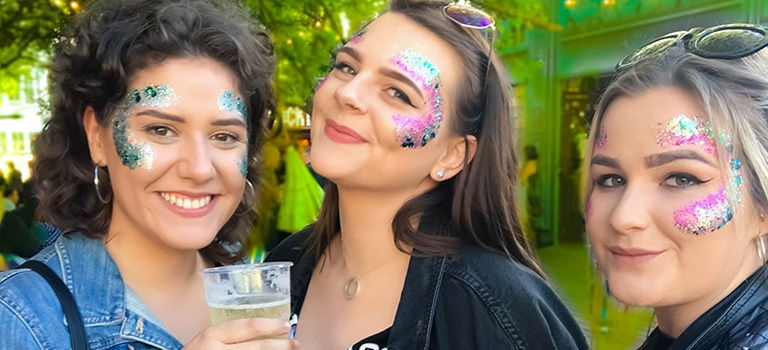 Some girls with glitter on their faces