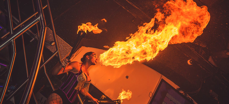 A person breathing fire in a club