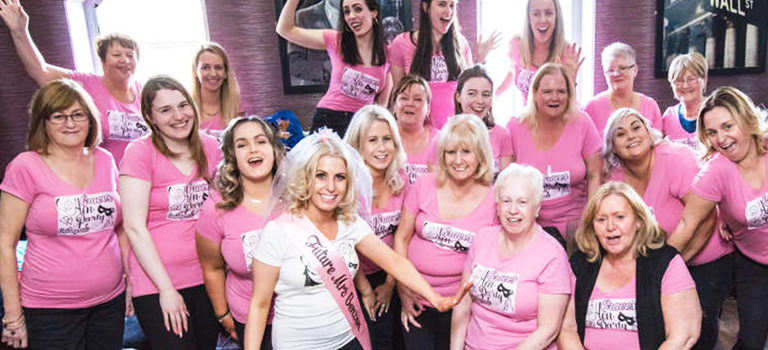 A group of hens in pink t-shirts