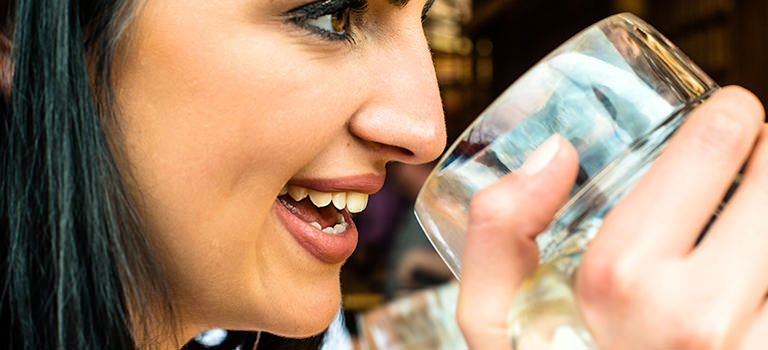 Woman drinking beer out of a stien