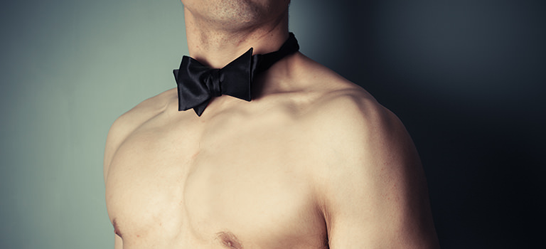 A naked man wearing a bowtie