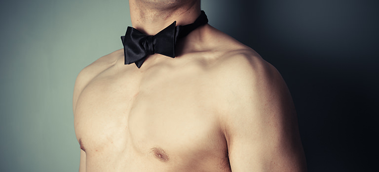 A naked man wearing a bow tie