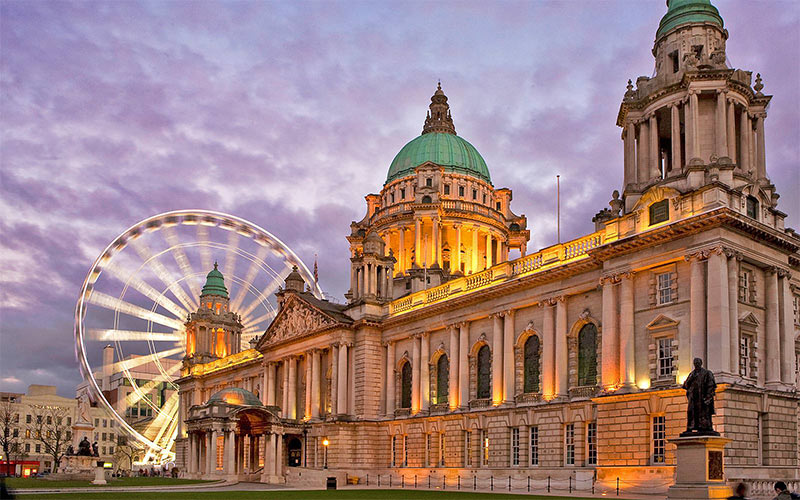 Belfast city centre illuminated with lights at dusk