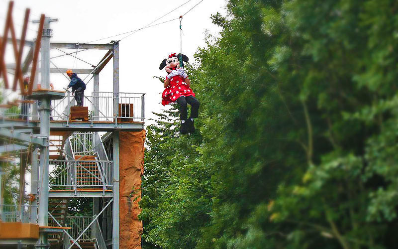 Someone zipwiring wearing a Minnie Mouse costume