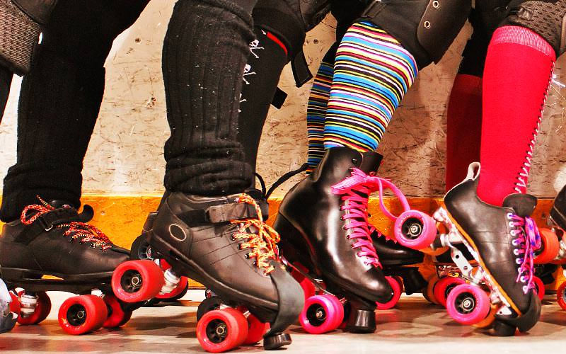 A close up of some women wearing rollerblades