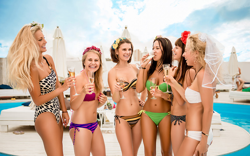 Six girls in bikinis by the poolside