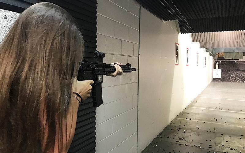 A girl firing a gun