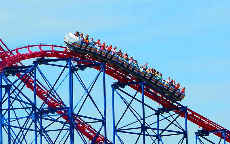 Some people on a rollercoaster in Blackpool's Pleasure Beach