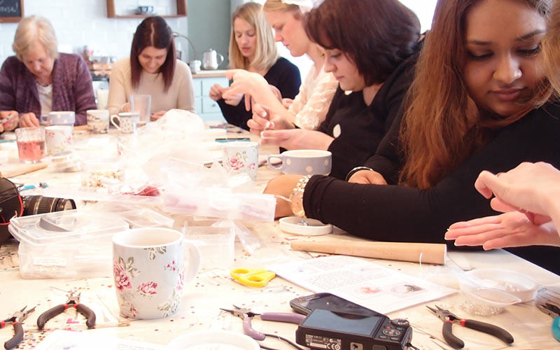 Some women doing a craft class