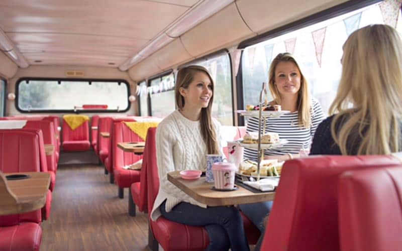 Some women on the bus having an afternoon tea