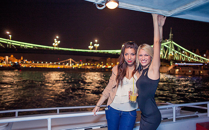Two girls on a nighttime cruise in Budapest