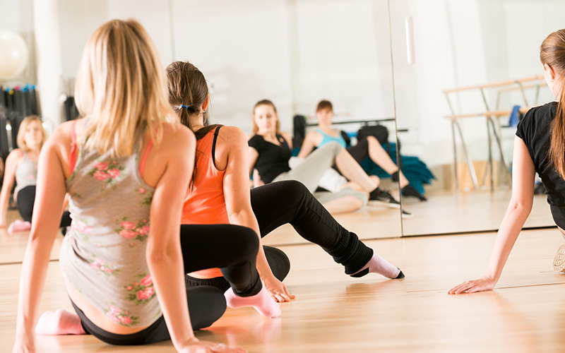 Some women doing a dance class in a studio