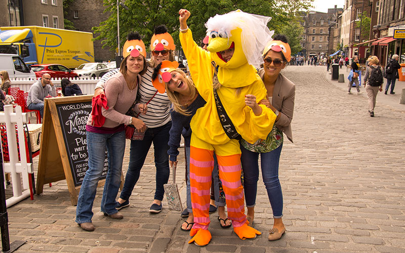Some women in Edinburgh with their freind who's dressed in hen party fancy dress