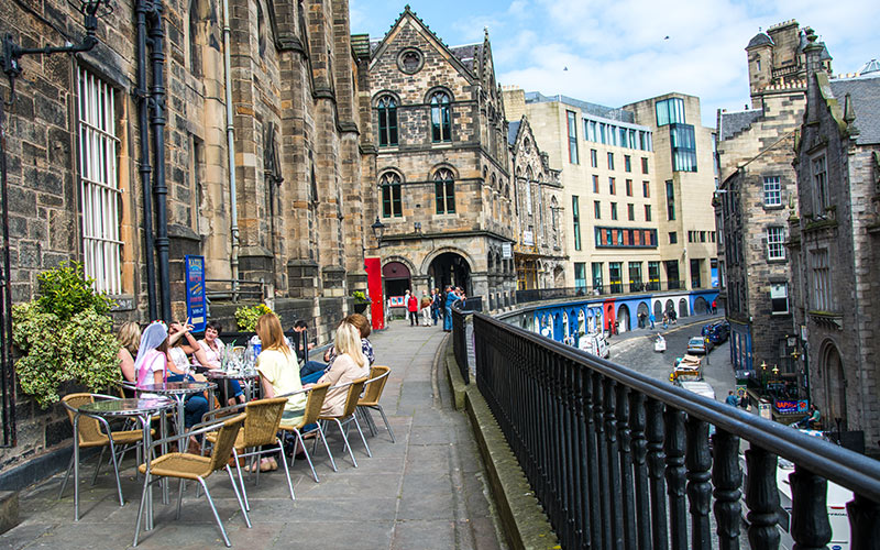 Some women having lunch on a terrace in Edinburgh's Victoria Street