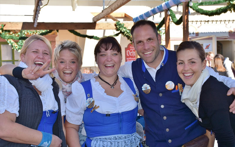 A group of women and a man in Bavarian outfits