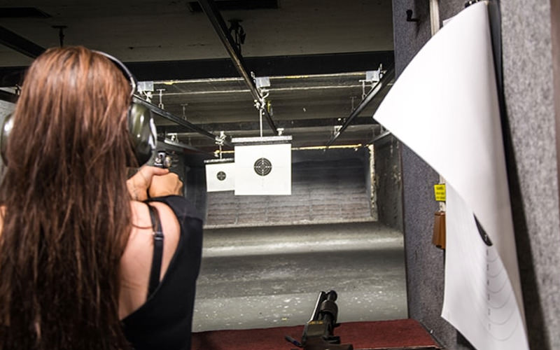 The back of a girl's head in a shooting range