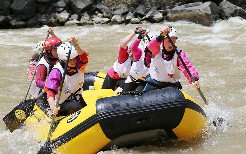Some girls white water rafting
