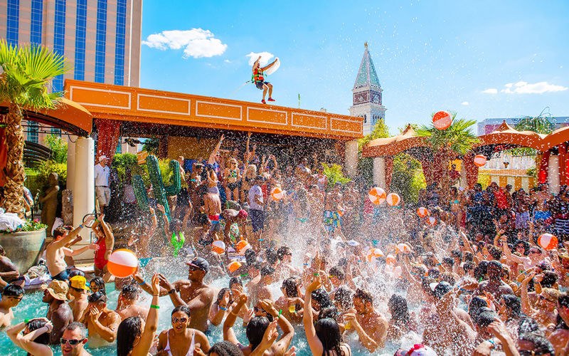 Lots of people partying in the sunshine, at a Vegas pool party