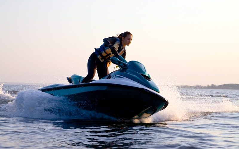 A girl riding a speed boat over the water