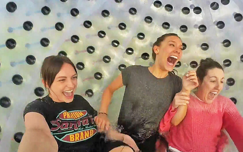 Three women inside an aquazorb