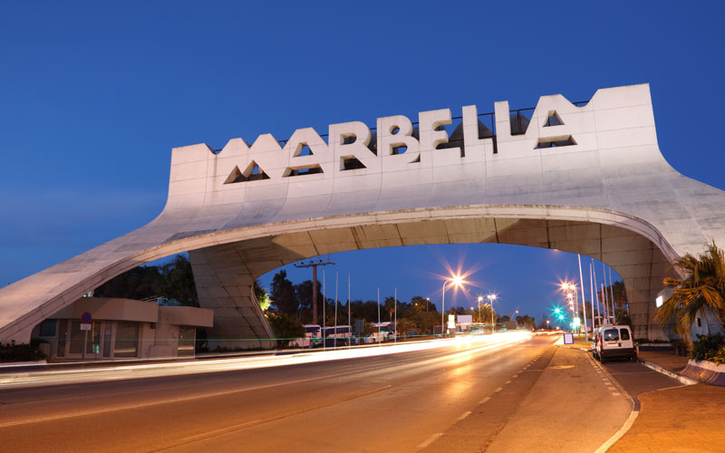 The iconic white Marbella sign over the road