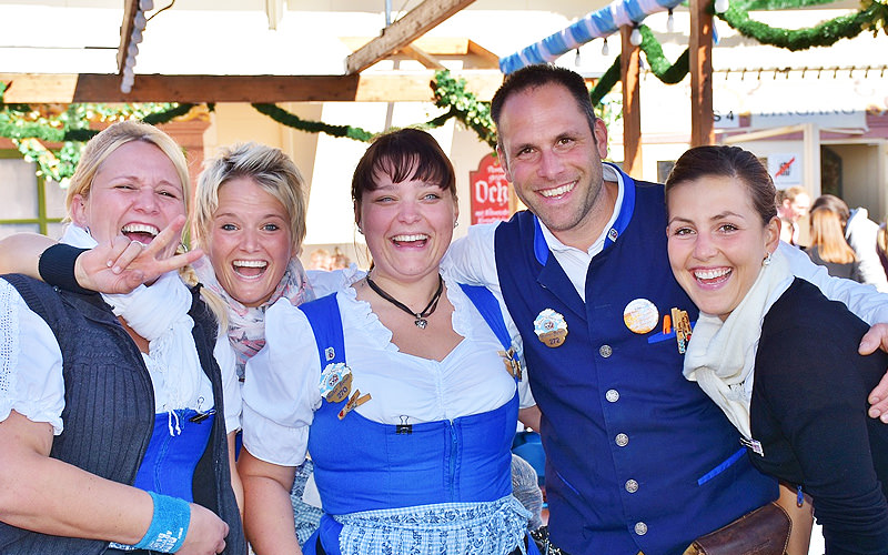 A group of women dressed in Bavarian clothes with one man