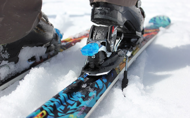 A close up of a pair of skis in the snow