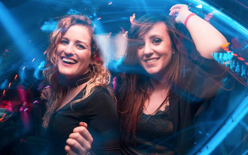 Two girls dancing in a club