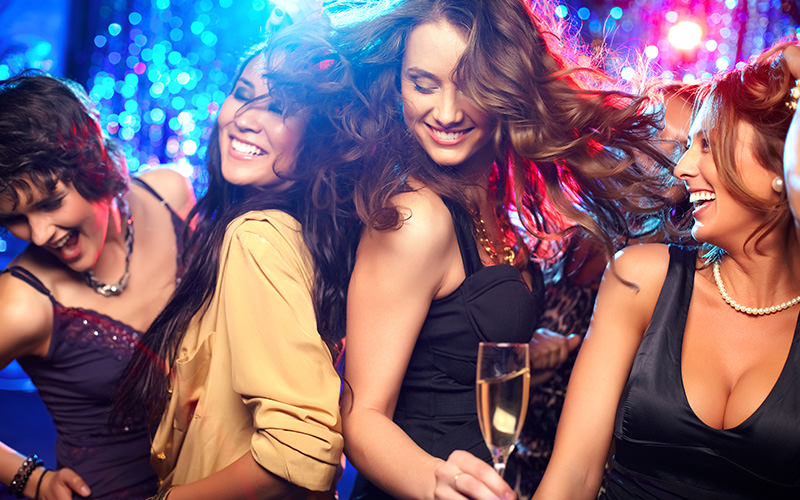 A group of girls dancing and smiling