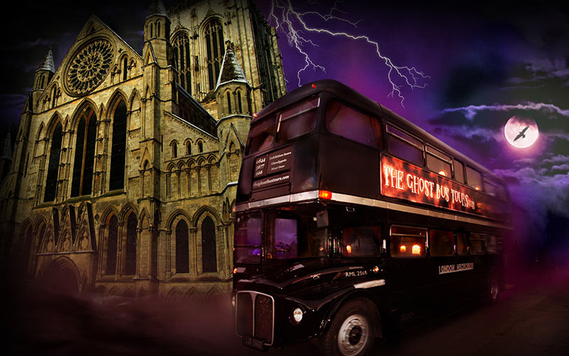 A bus with a ghost tour banner on it, with a cathedral and lightning in the background