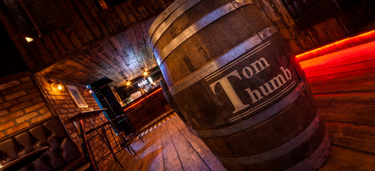 Tom Thumb written on a barrel